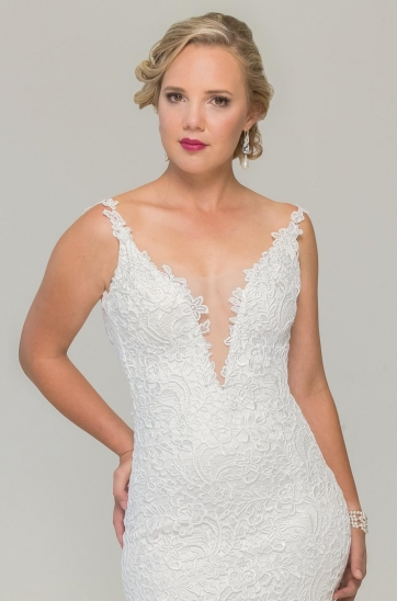 Ivory corded lace dress in a sheath silhouette, illusion plunging neckline, thin lace straps, low back and chapel train.